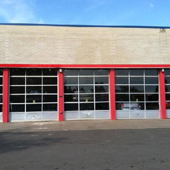Commercial door installation belle tire white lake mi for Garage door companies in michigan